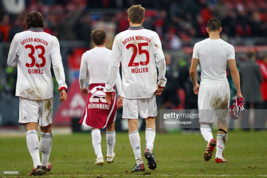 Mario Gomez of Bayern, Philipp Lahm, Thomas Mueller and Diego Contento walk off the pitch dejected after a 1-1 draw of the Bundesliga match between 1. FC Nuernberg and FC Bayern Muenchen at Easy Credit Stadium on February 20, 2010 in Nuremberg, Germany.