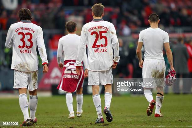 Mario Gomez of Bayern Philipp Lahm Thomas Mueller and Diego Contento walk off the pitch dejected after a 11 draw of the Bundesliga match between 1 FC...