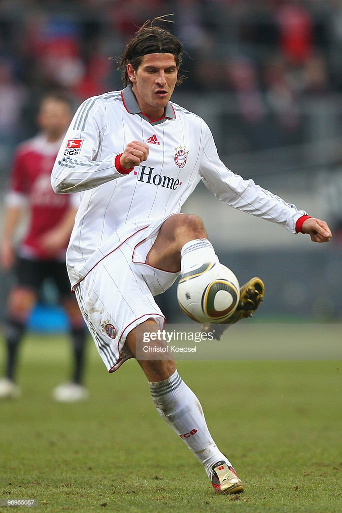 Mario Gomez of Bayern runs with the ball during the Bundesliga match between 1. FC Nuernberg and FC Bayern Muenchen at Easy Credit Stadium on February 20, 2010 in Nuremberg, Germany.