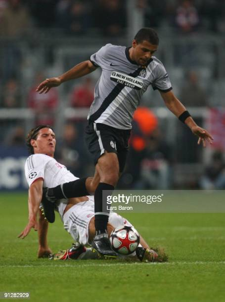 Mario Gomez of Bayern tackles Felipe Melo of Juventus during the UEFA Champions League Group A match between FC Bayern Muenchen and Juventus Turin at...