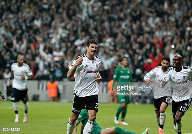 Mario Gomez of Besiktas celebrates after scoring a goal during the Turkish Super Toto Super Lig football match between Besiktas and Bursaspor at...