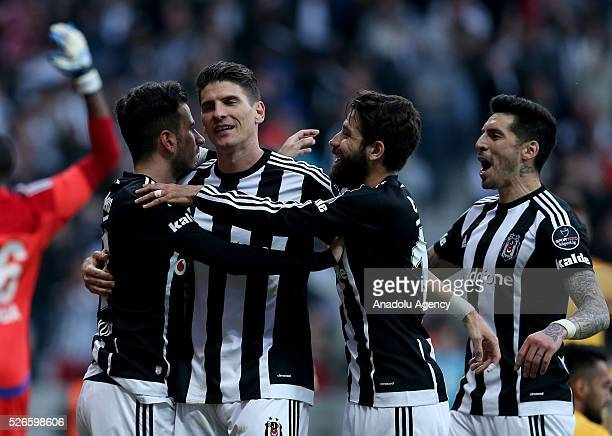 Mario Gomez of Besiktas celebrates with teammates after scoring a goal during the Turkish Super Toto Super Lig football match between Besiktas and...