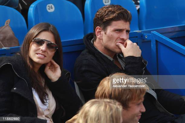 Mario Gomez of FC Bayern Muenchen and girlfriend Silvia Meichel attend the final match between Florian Mayer of Germany and Nikolay Davydenko of...