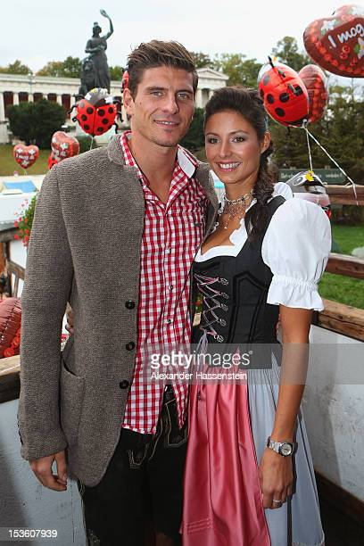 Mario Gomez of FC Bayern Muenchen attends with Silvia Meichel the Oktoberfest beer festival at the Kaefer Wiesnschaenke tent on October 7 2012 in...