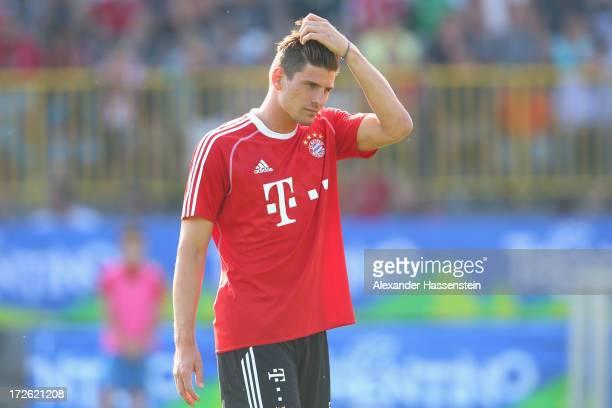 Mario Gomez of FC Bayern Muenchen reacts during a training session at Campo Sportivo on July 4 2013 in Arco Italy