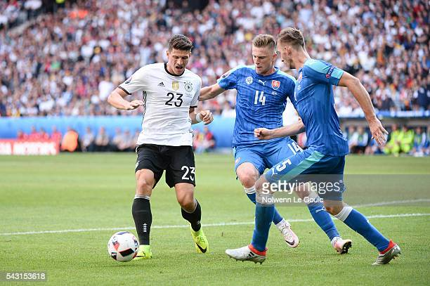 Mario Gomez of Germany and Milan Skriniar of Slovakia during the European Championship match Round of 16 between Germany and Slovakia at Stade...