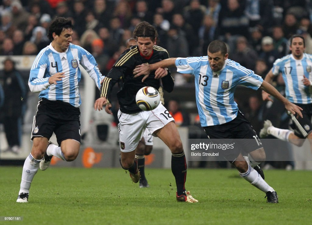 Mario Gomez (C) of Germany battles for the ball with Nicolas Burdisso (L) and Walter Samuel (R) of Argentina during the International Friendly match between Germany and Argentina at the Allianz Arena on March 3, 2010 in Munich, Germany.