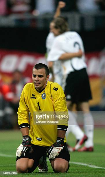 Mario Gomez of Germany celebrate the forth goal as goalkeeper Aldo Junior Simoncini of San Mariono is seen disappointed on the pitch during the UEFA...