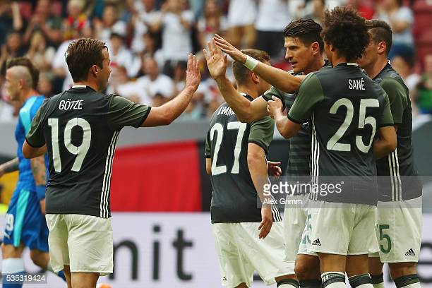 Mario Gomez of Germany celebrates his team's first goal with team mates during the international friendly match between Germany and Slovakia at...