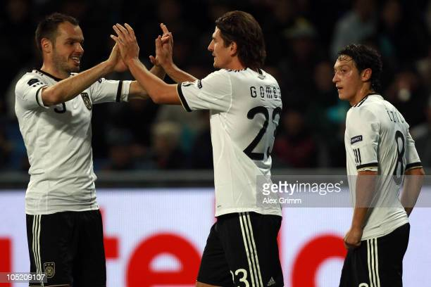 Mario Gomez of Germany celebrates his team's second goal with team mates Heiko Westermann and Mesut Oezil during the EURO 2012 group A qualifier...