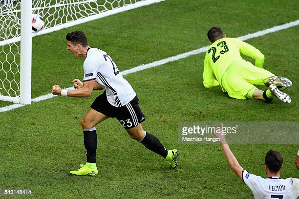 Mario Gomez of Germany celebrates scoring his team's second goal during the UEFA EURO 2016 round of 16 match between Germany and Slovakia at Stade...