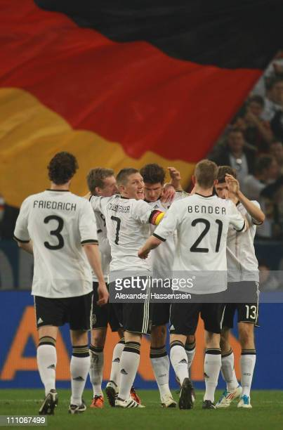 Mario Gomez of Germany celebrates scoring the first goal with his team mates during the international friendly match between Germany and Australia at...