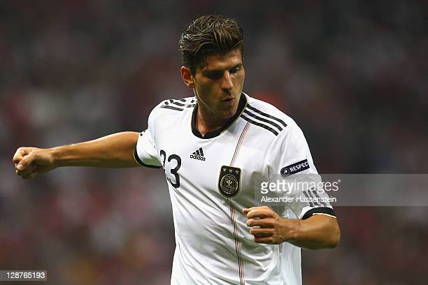 Mario Gomez of Germany celebrates scoring the opening goal during the UEFA EURO 2012 Group A qualifying match between Turkey and Germany at Tuerk...