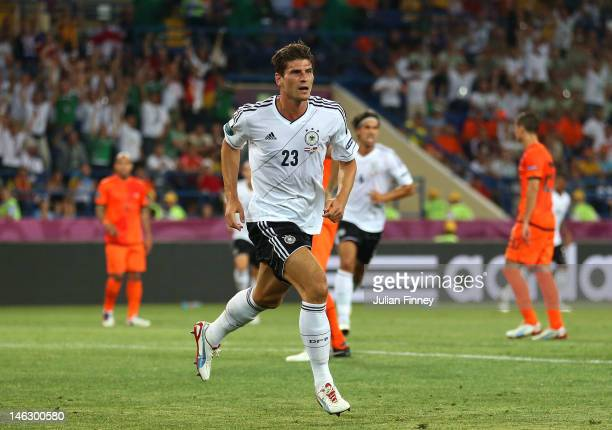 Mario Gomez of Germany celebrates scoring the opening goal during the UEFA EURO 2012 group B match between Netherlands and Germany at Metalist...