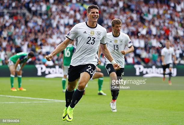 Mario Gomez of Germany celebrates scoring the opening goal during the UEFA EURO 2016 Group C match between Northern Ireland and Germany at Parc des...