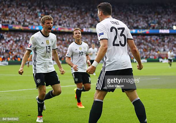 Mario Gomez of Germany celebrates scoring the opening goal with his team mate Thomas Mueller during the UEFA EURO 2016 Group C match between Northern...