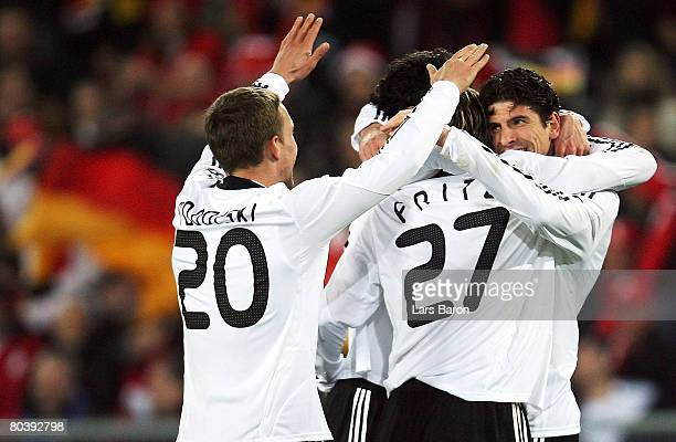 Mario Gomez of Germany celebrates scoring the second goal with team mates during the international friendly match between Switzerland and Germany at...