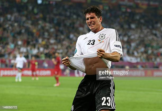L'VIV UKRAINE JUNE 09 Mario Gomez of Germany celebrates scoring their first goal during the UEFA EURO 2012 group B match between Germany and Portugal...