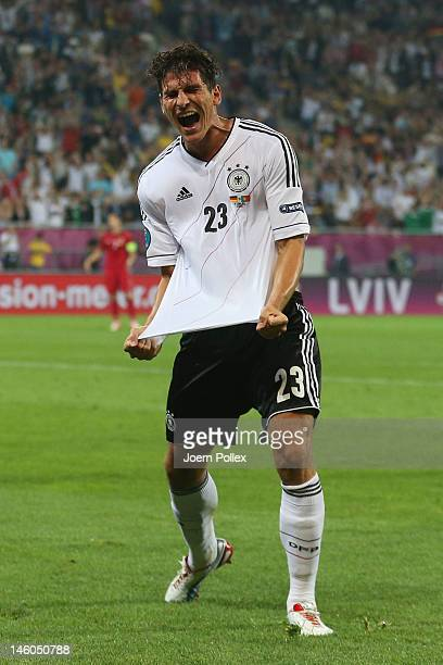 Mario Gomez of Germany celebrates scoring their first goal during the UEFA EURO 2012 group B match between Germany and Portugal at Arena Lviv on June...