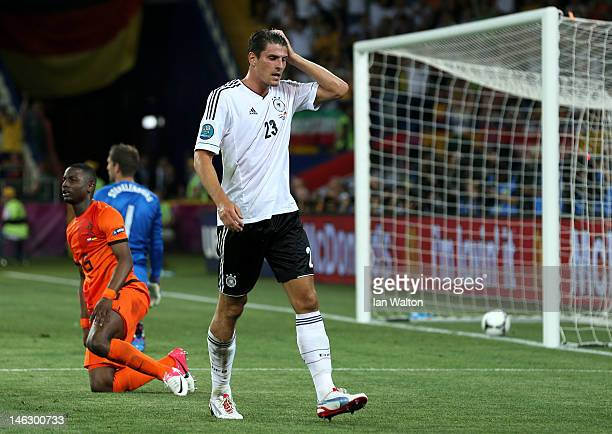 Mario Gomez of Germany celebrates scoring their second goal during the UEFA EURO 2012 group B match between Netherlands and Germany at Metalist...