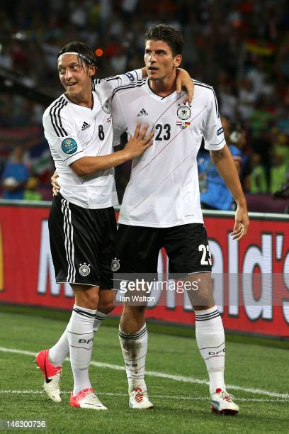 Mario Gomez of Germany celebrates scoring their second goal with Mesut Ozil of Germany during the UEFA EURO 2012 group B match between Netherlands...