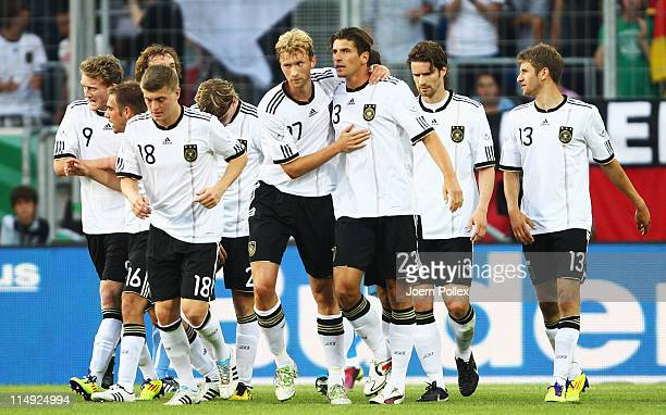 Mario Gomez of Germany celebrates with his team mates after scoring his team's frist goal during the international charity match between Germany and...