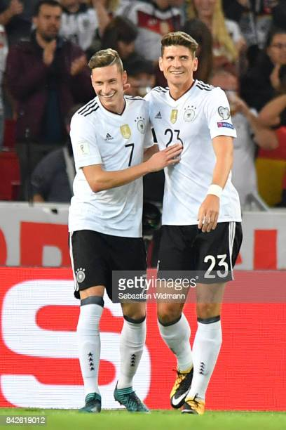 Mario Gomez of Germany celebrates with Joshua Kimmich of Germany after he scored to make it 60 for Germany during the FIFA 2018 World Cup Qualifier...