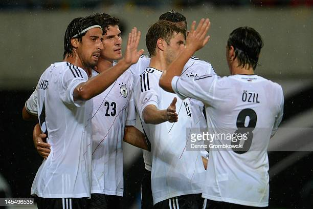 Mario Gomez of Germany celebrates with teammates Sami Khedira, Mesut Oezil, Jerome Boateng and Thomas Mueller after scoring his team's opening goal...
