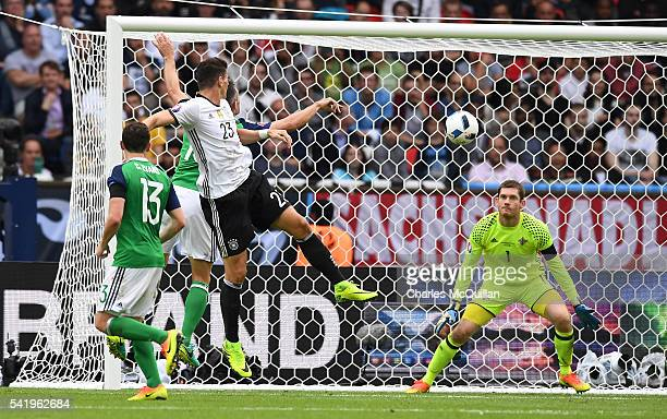 Mario Gomez of Germany heads at goal during the UEFA EURO 2016 Group C match between Northern Ireland and Germany at Parc des Princes on June 21 2016...