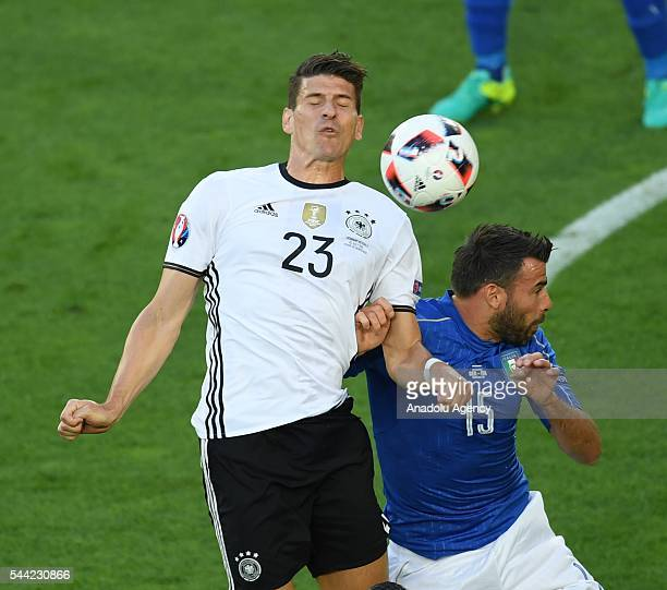 Mario Gomez of Germany in action against Andrea Barzagli of Italy during the UEFA Euro 2016 quarter final match between Germany and Italy at Stade de...