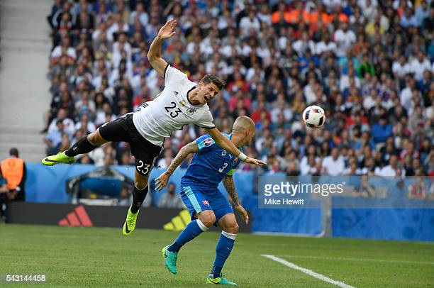 Mario Gomez of Germany is fouled by Martin Skrtel of Slovakia in the area resuting in a penalty kick during the UEFA EURO 2016 round of 16 match...