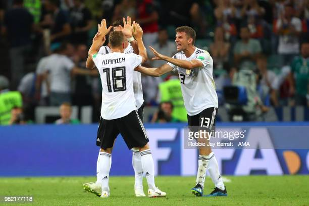 Mario Gomez of Germany Joshua Kimmich and Thomas Mueller of Germany celebrate at the end of the 2018 FIFA World Cup Russia group F match between...