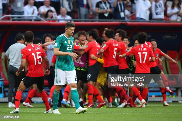Mario Gomez of Germany looks dejected as Korea Republic celebrate during the 2018 FIFA World Cup Russia group F match between Korea Republic and...