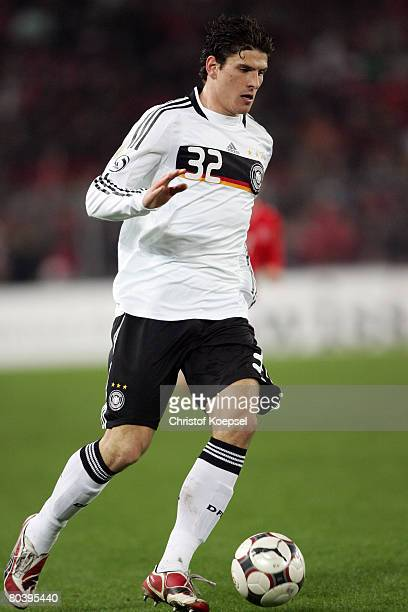 Mario Gomez of Germany runs with the ball during the international friendly match between Switzerland and Germany at the St JakobPark on March 26...