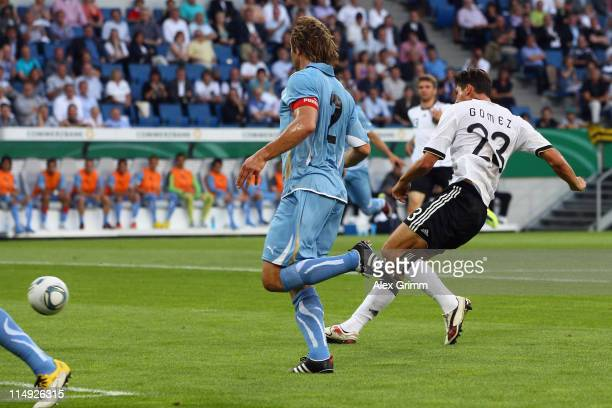 Mario Gomez of Germany scores his team's first goal during the international friendly charity match between Germany and Uruguay at RheinNeckar Arena...