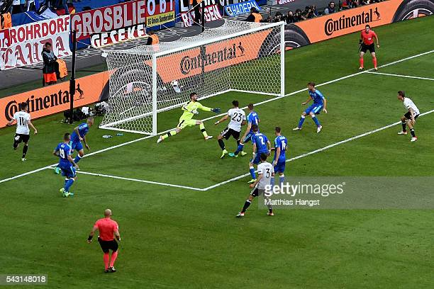 Mario Gomez of Germany scores his team's second goal past Matus Kozacik of Slovakia during the UEFA EURO 2016 round of 16 match between Germany and...