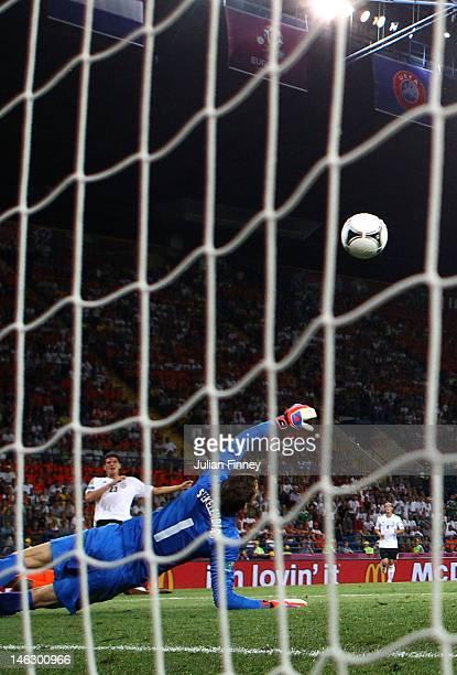 Mario Gomez of Germany scores their second goal past Maarten Stekelenburg of Netherlands during the UEFA EURO 2012 group B match between Netherlands...