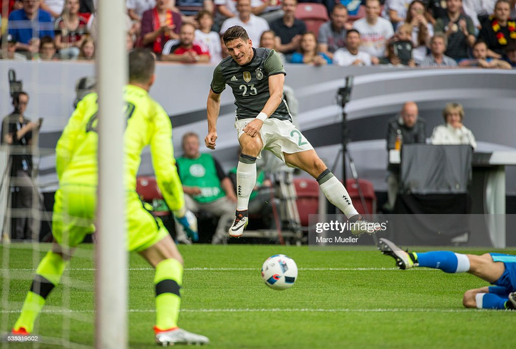 Mario Gomez (M) of Germany shoots while the goalkeeper of Slovakia Matus Kozacik (l) is defending during the international friendly match between Germany and Slovakia at WWK-Arena on May 29, 2016 in Augsburg, Germany.