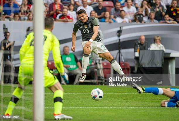 Mario Gomez of Germany shoots while the goalkeeper of Slovakia Matus Kozacik is defending during the international friendly match between Germany and...
