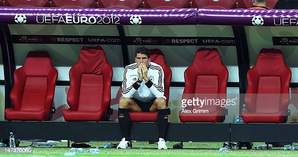 Mario Gomez of Germany shows his dejection as he sits on the bench after the UEFA EURO 2012 semi final match between Germany and Italy at National...