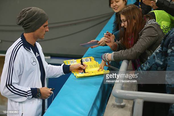 Mario Gomez of Germany signs autographs prior the FIFA 2014 World Cup qualifier group C match between Kazakhstan and Germany at Astana Arena on March...