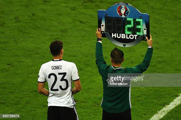 Mario Gomez of Germany stands on the touchline to be brought in during the UEFA EURO 2016 Group C match between Germany and Poland at Stade de France...