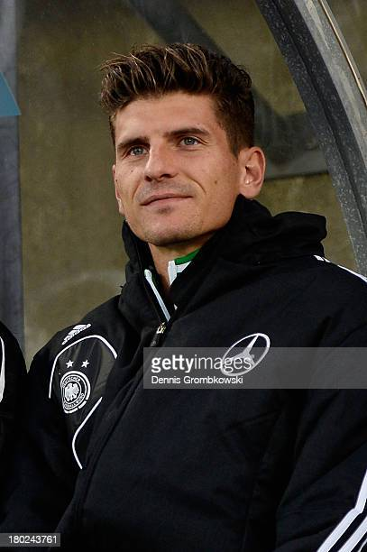 Mario Gomez of Germany takes seat on the bench prior to the FIFA 2014 World Cup Qualifier match between Faeroe Islands and Germany on September 10...