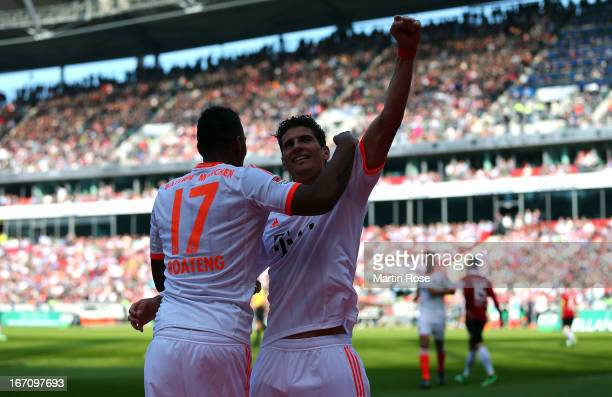Mario Gomez of Muenchen celebrate with team mate Jerome Boateng after he scores his team's 4th goal during the Bundesliga match between Hannover 96...