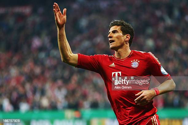 Mario Gomez of Muenchen celebrates his team's fifth goal during the DFB Cup Semi Final match between Bayern Muenchen and VfL Wolfsburg at Allianz...