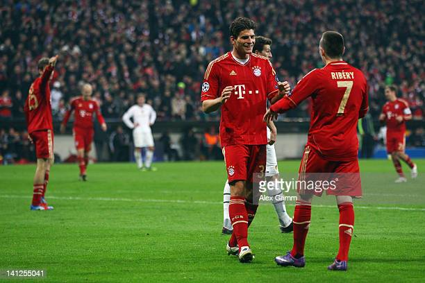 Mario Gomez of Muenchen celebrates his team's fifth goal with team mate Franck Ribery during the UEFA Champions League Round of 16 second leg match...