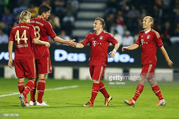 Mario Gomez of Muenchen celebrates his team's fifth goal with team mates Anatoliy Tymoshchuk, Xherdan Shaqiri and Arjen Robben during the friendly...