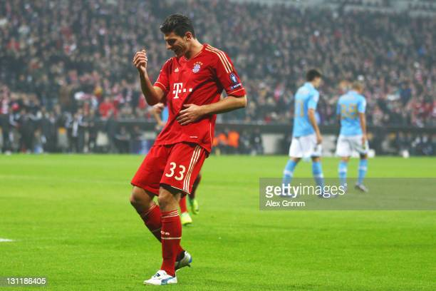 Mario Gomez of Muenchen celebrates his team's first goal during the UEFA Champions League group A match between FC Bayern Muenchen and SSC Napoli at...