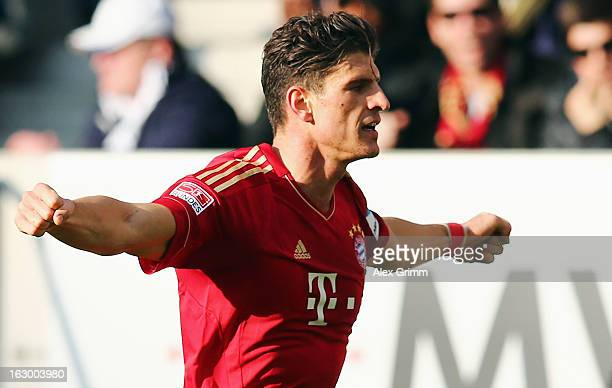 Mario Gomez of Muenchen celebrates his team's first goal during the Bundesliga match between TSG 1899 Hoffenheim and FC Bayern Muenchen at...