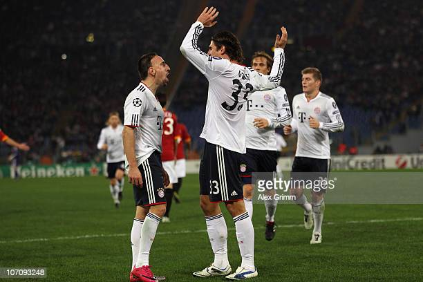 Mario Gomez of Muenchen celebrates his team's first goal with team mate Franck Ribery during the UEFA Champions League group E match between AS Roma...